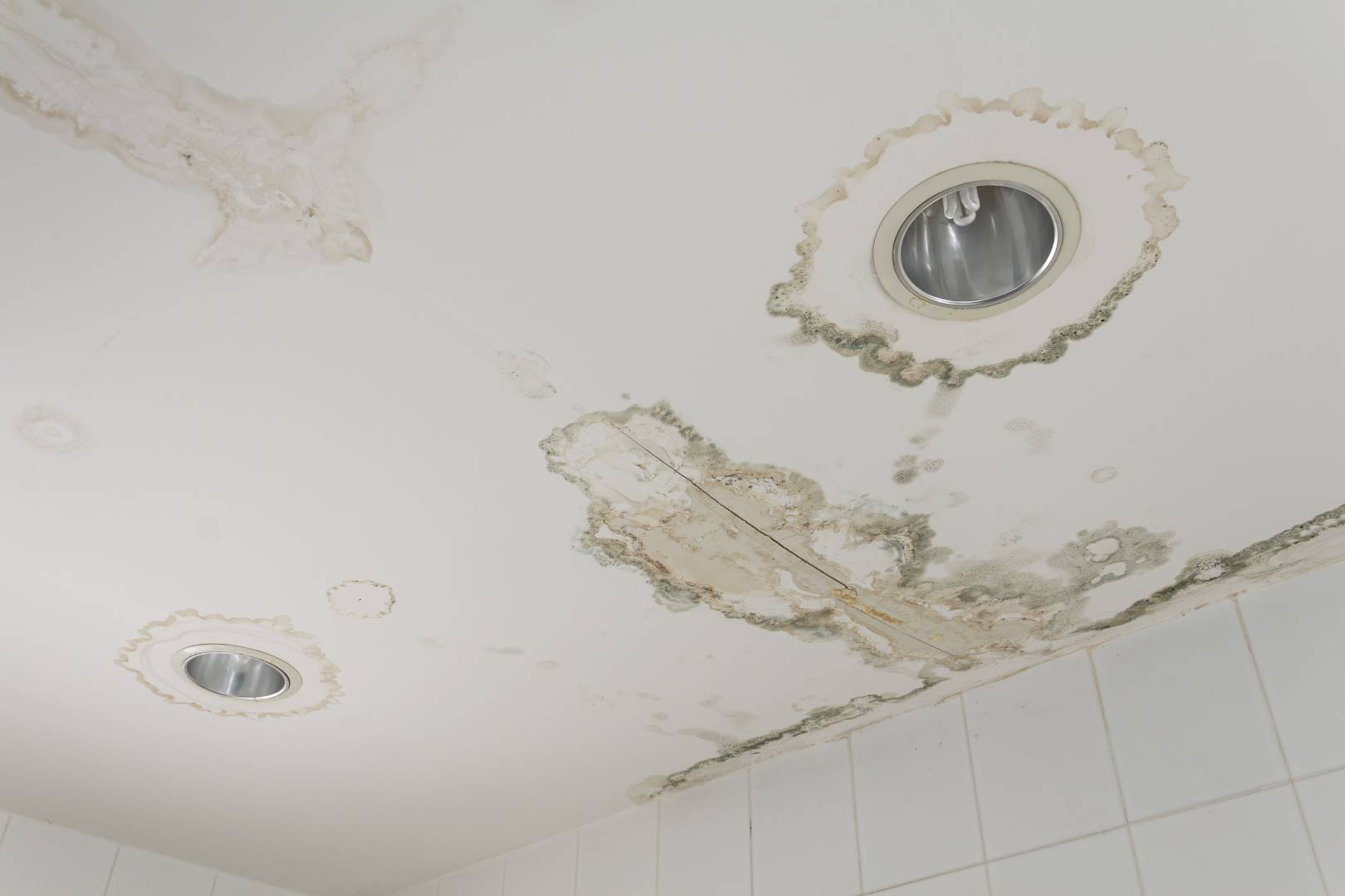 Water leaking from ceiling when water damage goes untreated.